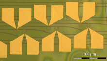 Microscope image of the fabricated device with splits for various microring-waveguide coupling distances.